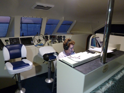 catherine operating radio on boat