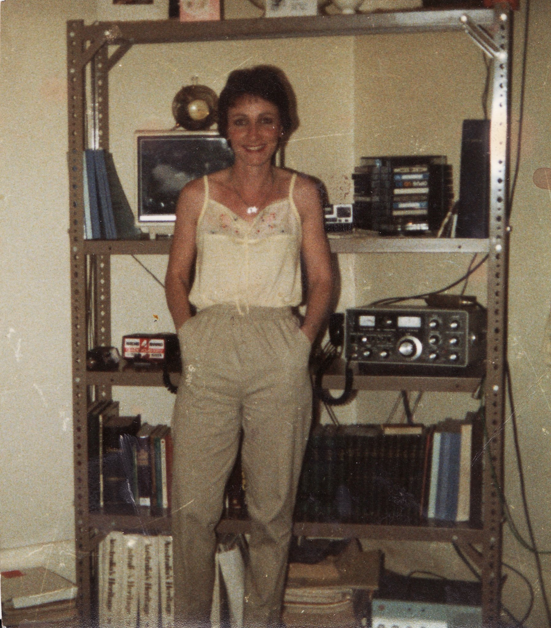 sue standing in front of radios